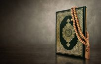 Quran holy book with rosary beads